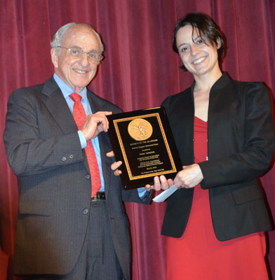 Myron Kandel presenting the Dennis Duggan Award to Irina Ivanova - photo by Allan Dodds Frank